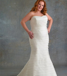 Расширение модной юбки у такого платья должно начинаться от середины бедра, но, ни в коем случае не ниже колена